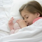 girl sleeping with thumb in mouth