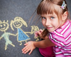 child drawing in chalk