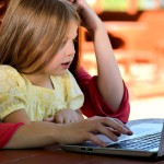 Child with mum on laptop